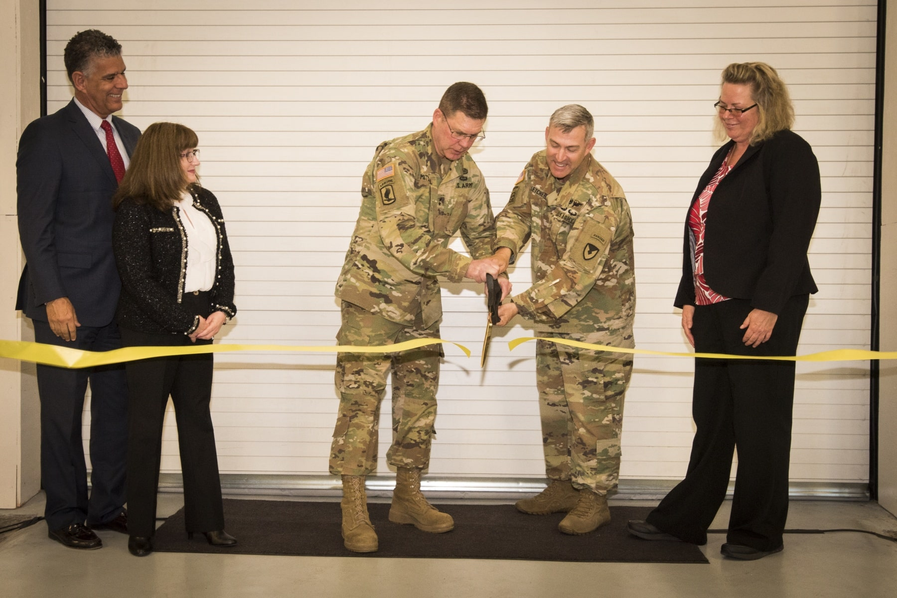 Gen. Daniel Mitchell (center left), commanding general, U.S. Army Tank-Automotive and Armaments Command, and Col. Ken Letcher (center right), commander, Rock Island Arsenal Joint Manufacturing and Technology Center, cut the ribbon on the new Advanced and Additive Manufacturing Center of Excellence at Rock Island Arsenal, Illinois, May 15. (U.S. Army photo by Kevin Fleming/Army Sustainment Command) (Photo Credit: Courtesy of U.S. Army RIA-JMTC)